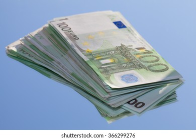 Euro banknotes on blue background