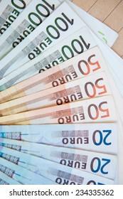 euro banknotes on brown envelope