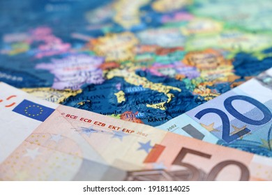 Euro banknotes on the Europe map. Concept of Eurozone, European economy, stock market in EU - Shutterstock ID 1918114025