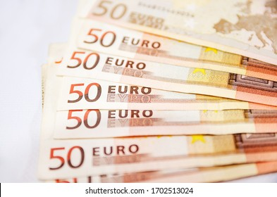 a lot of euro banknotes on white. 50 euros on the table. Money background. Close-up. Selective focus.