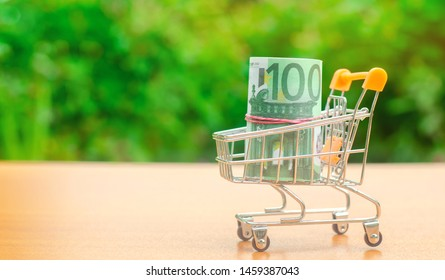 Euro banknotes in a supermarket trolley. Money Management. Money market. Sale, discounts and low prices. Gift certificate for purchase. Contribution and investment. Cashback. Credit and loan