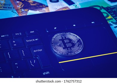 Euro bills, black keyword and metal souvenir bitcoin. The concept of electronic money, online trading, mining and commerce. Cryptocurrency and cash.