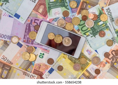 euro bills with coin, smartphone