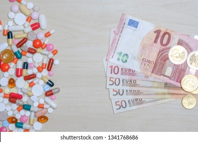 Euro bills and colored pills on a light background. Tablets money concept.