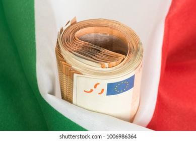 Euro bills and Italian flag