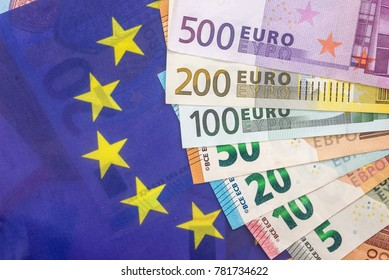 euro bills on the european flag background.