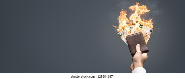 Euro bills in a wallet burning with a bright flame as a panorama