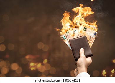 Euro bills in a wallet burning with a bright flame