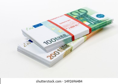 Euro cash in bundles of one hundred and two hundred banknotes, Euro money Euro on a white background, isolated on a white background