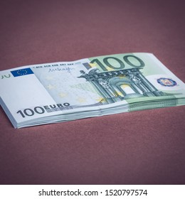 Euro cash on a pink and brown background. Euro Money Banknotes. Euro Money. Euro bill. Place for text.