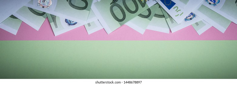 Euro cash on a pink and green background. Euro Money Banknotes. Euro Money. Euro bill. Place for text.