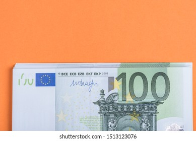 Euro cash on a pink and orange background. Euro Money Banknotes. Euro Money. Euro bill. Place for text.