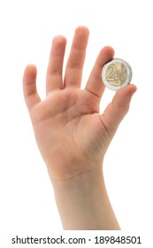 Euro coin in child hand, two Euros coin, hand with coin isolated over white