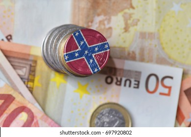 euro coin with confederate navy jack flag on the euro money banknotes background. finance concept