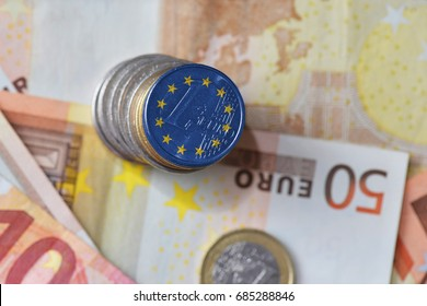 euro coin with flag of european union on the euro money banknotes background. finance concept