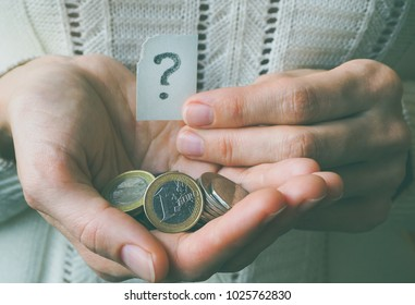 Euro coin in hand and a question mark.