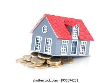 Euro coin and house model on white background