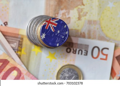 euro coin with national flag of australia on the euro money banknotes background. finance concept