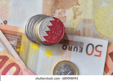 euro coin with national flag of bahrain on the euro money banknotes background. finance concept