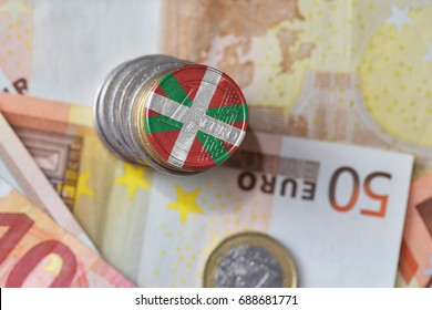 euro coin with national flag of basque country on the euro money banknotes background. finance concept