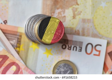 euro coin with national flag of belgium on the euro money banknotes background. finance concept