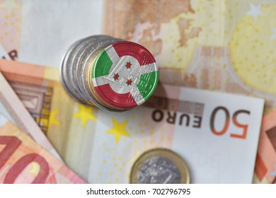 euro coin with national flag of burundi on the euro money banknotes background. finance concept
