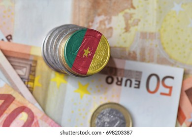euro coin with national flag of cameroon on the euro money banknotes background. finance concept