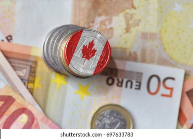 euro coin with national flag of canada on the euro money banknotes background. finance concept