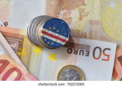 euro coin with national flag of cape verde on the euro money banknotes background. finance concept