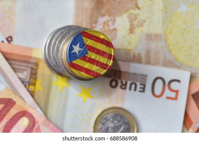 euro coin with national flag of catalonia on the euro money banknotes background. finance concept