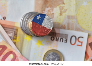 euro coin with national flag of chile on the euro money banknotes background. finance concept