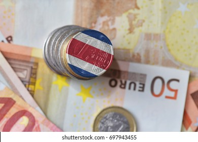 euro coin with national flag of costa rica on the euro money banknotes background. finance concept