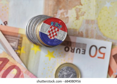 euro coin with national flag of croatia on the euro money banknotes background. finance concept
