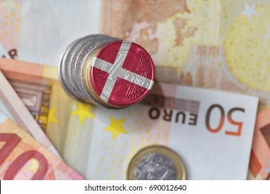 euro coin with national flag of denmark on the euro money banknotes background. finance concept