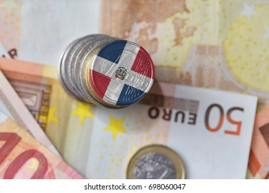 euro coin with national flag of dominican republic on the euro money banknotes background. finance concept