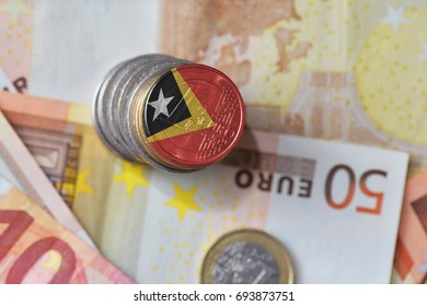 euro coin with national flag of east timor on the euro money banknotes background. finance concept