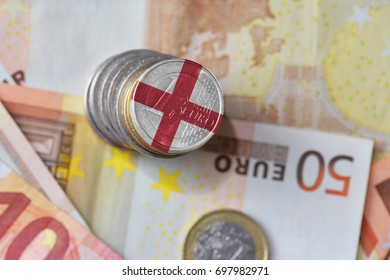 euro coin with national flag of england on the euro money banknotes background. finance concept