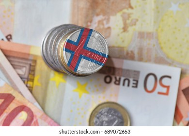 euro coin with national flag of faroe islands on the euro money banknotes background. finance concept