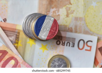 euro coin with national flag of france on the euro money banknotes background. finance concept