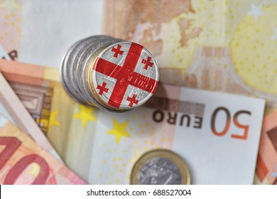 euro coin with national flag of georgia on the euro money banknotes background. finance concept