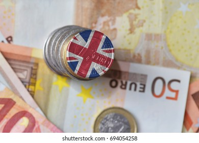 euro coin with national flag of great britain on the euro money banknotes background. finance concept
