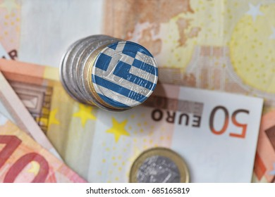 euro coin with national flag of greece on the euro money banknotes background. finance concept
