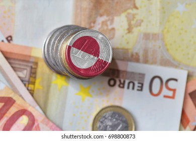 euro coin with national flag of greenland on the euro money banknotes background. finance concept
