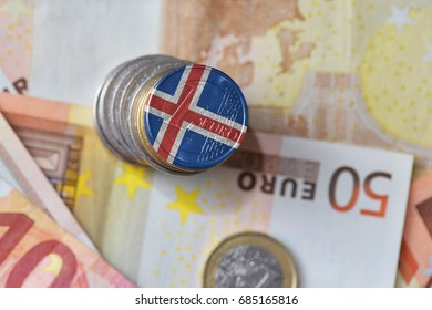 euro coin with national flag of iceland on the euro money banknotes background. finance concept