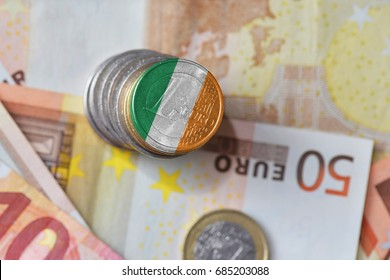 euro coin with national flag of ireland on the euro money banknotes background. finance concept