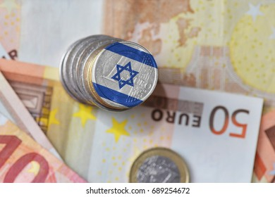 euro coin with national flag of israel on the euro money banknotes background. finance concept
