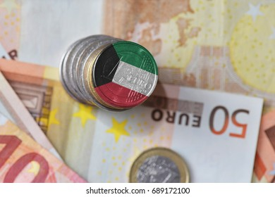 euro coin with national flag of kuwait on the euro money banknotes background. finance concept