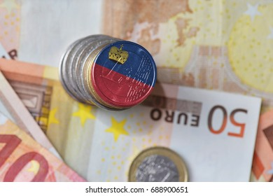 euro coin with national flag of liechtenstein on the euro money banknotes background. finance concept
