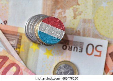 euro coin with national flag of luxembourg on the euro money banknotes background. finance concept