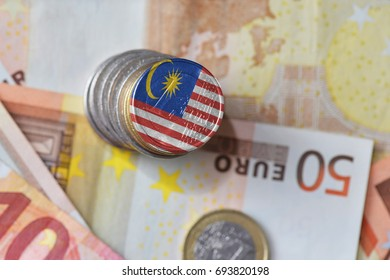 euro coin with national flag of malaysia on the euro money banknotes background. finance concept
